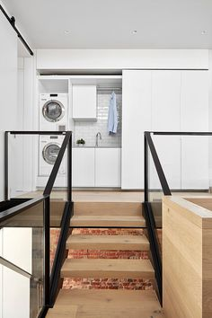 Mark St, Fitzroy North Laundry landing, timber floors, steel and glass handrail, exposed brick walls