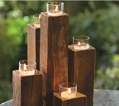 Wood Pylon Candelabra. Joined together in staggered heights, these reclaimed elm wood cubes create unusual tealight holders. Their rustic elegance and weather-worn character add boldly original texture and shape to indoor or outdoor.