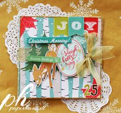 An awesome DIY album by Trina McClune.  This was posted on Dec 12, 2013 on PaperHaus blog.  She has a brief tutorial on how to make it.