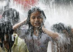 Reuters Children Rain Manila