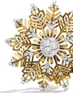 18 Karat Gold and Diamond 'Snowflake' Brooch, Van Cleef & Arpels. The openwork snowflake set with old European and single-cut diamonds ~ 7.35 carats, circa 1945.