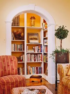 Great idea for a mini-library nook....build a fancy archway in front of the opening to an old closet, install a light fixture inside,  paint inside walls and install shelves. I love this.