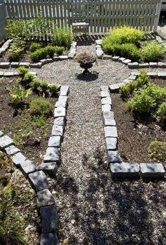 I like the cross idea for a garden. I would make one smaller then this and fill it with some pea stone.