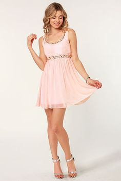 Cute light pink dress with rhinestone touches, perfect for a spring day out