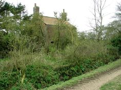 The abandoned cottage stands isolated and some distance away from the nearest houses. It is surrounded by fields on all sides, with a farm track provi Derelict House, Farm Cottage, Abandoned Houses, Norfolk, Decay, Fields, Places To Visit, Country Roads, Beautiful