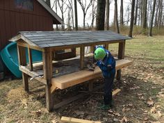 My son assisting in the nesting box build out. Box Building, Nesting Boxes, Side Door, Cinder, Chickens Backyard, Coops, Rear View, Picnic Table, Outdoor Furniture