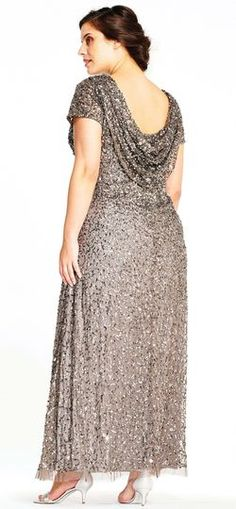 Go for plenty of shine in this all new silhouette. Featuring our signature crunchy sequin beading, short sleeves, and a draped cowl back, this formal dress is unparalleled. A modified skirt gives this dress a mermaid-esque silhouette. Paired with matching heels, this gown is ready for every formal event. We love this beaded gown for bridal parties and galas. Adrianna Papell