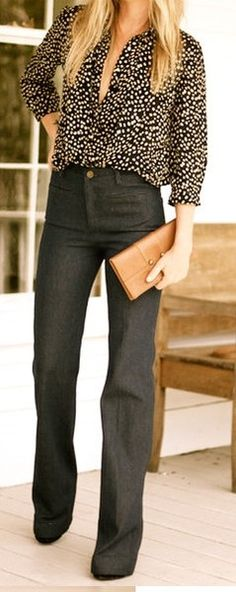 Tucked in polka dot blouse and flared jeans