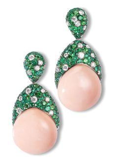 de GRISOGONO one of a kind high jewellery coral cabochon earrings held by a beautiful pave of Emeralds and white diamonds