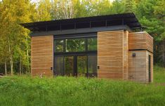 In September 2009, Bill and Daniel Yudchitz bought a 2.78-acre lot that had water access to Lake Superior's Chequamegon Bay. Many of the properties they looked at required a larger minimum building footprint than they desired; their cabin needed to be small to reduce its environmental impact.  Inspired by Swiss Pritzker Prize-winning architect Peter Zumthor, the Yudchitzes designed and crafted an exquisitely precise interior within the 325 square-foot dwelling.