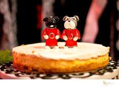 Our Wedding cheesecake. With custom toppers. Schnauzer and mini boz. Ohio state buckeyes