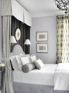 blue gray walls and upholstered bed. green beige canopy and drapery.
