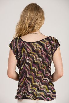 Just 2 skeins result in this lovely tunic that is an assymetrical unusual knit that can be sleeveless (shown in Black Magic Kit) or with short sleeves (shown in Red Sunset Kit).
