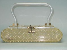 Such a pretty Florida Handbag documented in Carry Me -- called CASKET purse -- RARE Starburst and lace pattern