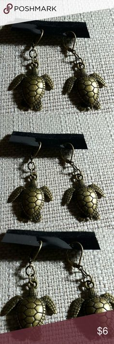 Antique Bronze turtle dangle earrings Antique Bronze turtle dangle earrings.   Light weight   Antique Bronze ear wires hypoallergenic. Comes with inspirational quote refrigerator/office desk magnet. Jewelry Earrings