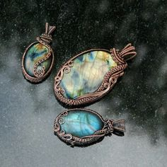 I made these freeform copper wire wrapped labradorite pendants