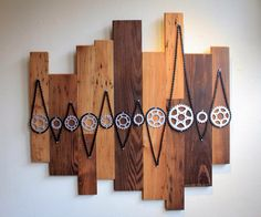 Upcycled bike parts donated by local shops, mounted to reclaimed wood flooring pieces from a house in Telluride, CO.