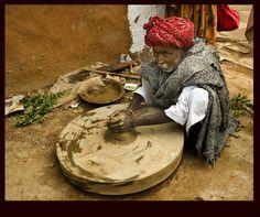 Village potter at work. (Abhaneri Rajasthan)  By: Sergio Occhiuzzo  |