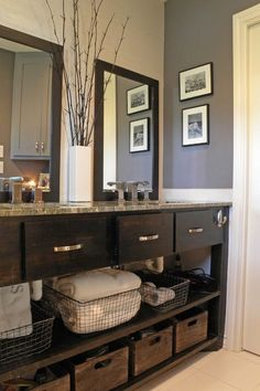 The dark gray paint goes well with the dark wood of the sink cabinet... http://www.bathroom-paint.net/bathroom-paint-color.php