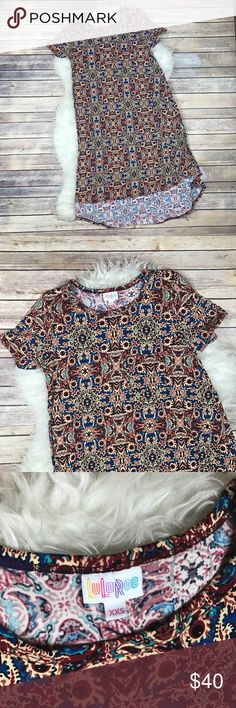 """LuLaRoe Mosaic Carly Dress Excellent condition, like new LuLaRoe Carly Dress. Size XXS. Black, blue and deep red. 96% polyester, 4% spandex. Made in USA. High/low styling. Bust 35"""", waist 45"""", hips 62"""", length at front 37"""", length at back 43"""". No trades, offers welcome. LuLaRoe Dresses High Low"""