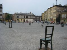 The sculptural composition features 33 iron chairs on the site of the former ghetto and 37 chairs standing on the edge of the square and at tram stops. The theme of empty chairs suggests that anyone can be a victim. It also speaks to the history of ghetto, when all the furniture from Jewish homes was being brought outside so that people wouldn't be able to hide their kids.