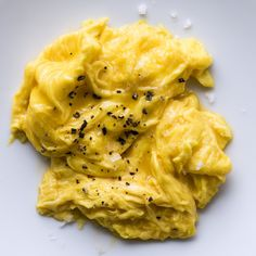 Medium-low heat is the key to the fluffy, creamy, melty texture of these eggs. We like to serve them when they're still runny, but keep them on the stove for another 15 seconds if you prefer them completely set.