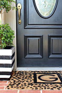 black and white modern DIY door mat, cheetah spot floor stencil, monogrammed door mat tutorial by Dimples and Tangles