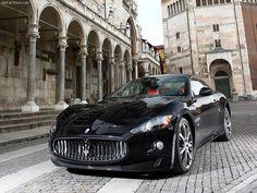 Black Maserati GranTurismo with a red interior around Italy