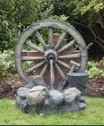 garden water features Cartwheel on Wall Fountain Water Feature uk Found it at Wayfair Polyresin and Fiberglass Tiered Wood Cask Fountain Garden Water Wheel Piper in Te. Diy Water Feature, Backyard Water Feature, Indoor Water Fountains, Garden Fountains, Fountain Garden, Solar Fountains, Outdoor Fountains, Wagon Wheel Decor, Wagon Wheel Garden