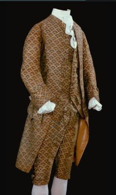 Suit Coat, Waistcoat, and Breeches 1760-1775; Britain; Compound-weave silk relined with modern silk and linen, breeches waistband lined with eighteenth-century linen-cotton, leather breeches pockets  Small-scale enclosed patterns such as the design of this silk textile were considered especially appropriate for men's suits.  Acc. Num: 1953-838, 1-3  Considering his other books, I think that this may have been what Robert Jordan had in mind when he mentioned coats, shirts, and breeches.
