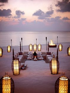 Beach dinner in the Maldives (with chairs dug into the sand!). ASPEN CREEK TRAVEL - karen@aspencreektravel.com