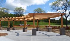 http://www.vermonttimberworks.com/home/projects/lake_taghkanic/images/ny-timber-frame-pergola.JPG