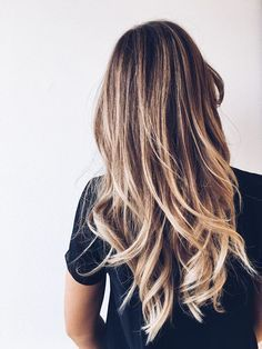 You can never go wrong with loose curls and long layers