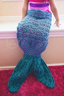 This is a PDF crochet pattern for a fun Mermaid Tail BLANKET. The fin is a pocket for the feet, and the top is a blanket that can be wrapped around the legs.