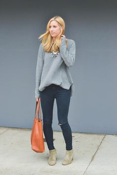 black skinny jeans, gray sweater, tan booties & a statement necklace...definitely duplicating this look soon