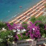 rows of sun umbrellas at commercially run beach in Positano, Amalfi Coast