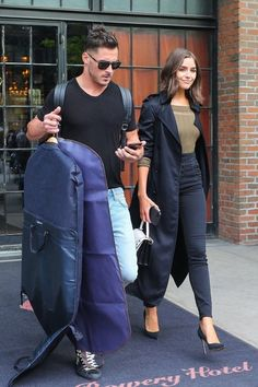 Olivia Culpo Photos - Danny Amendola and Olivia Culpo were spotted looking chic as they left the Bowery Hotel in the East Village of NYC. Danny carried their outfits to the waiting car in a clothes bags while Olivia strolled leisurely at his side. - Danny Amendola and Olivia Culpo Leave Their New York City Hotel