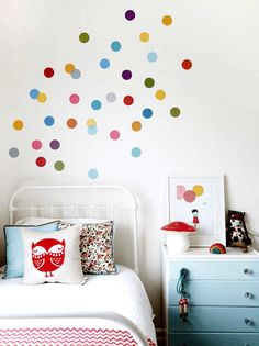 Multicolour confetti walls and light blue storage