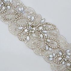 Fiore Couture Bridal Belts. Contemporary floral design with scallop edge, covered in beads and rhinestones. Incredible sparkle. Bridal accessories.