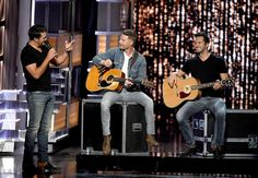 Luke Bryan Photos Photos - Co-hosts Luke Bryan (L) and Dierks Bentley (C) speak as a wax figure of Luke Bryan is displayed onstage during the 52nd Academy Of Country Music Awards at T-Mobile Arena on April 2, 2017 in Las Vegas, Nevada. - 52nd Academy of Country Music Awards - Show