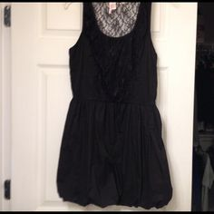 💖FINAL MARKDOWN!💗Black dress with lace detail. It has a bubble effect at the bottom. It fits more like a large. The lace is going down the front and is on the back as well. Looks adorable with heels or leggings and flats.  Only worn twice! Dresses