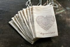 Wedding favor bags, muslin, 3x5. Set of 50. Lace heart and All You Need Is Love script in brown on natural white cotton. via Etsy
