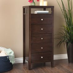 46.9 in. H x 17.7 in. W x 19.6 in. D Add style and function to your bedroom decor with this durable lingerie chest. Five drawers and an open upper area give you plenty of room for storage. With its rich Halifax brown finish, this chest will match a variety of decor styles.