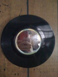 Upcycled Vinyl Record Mirror. Try a grouping of these in both 45's and 78's.