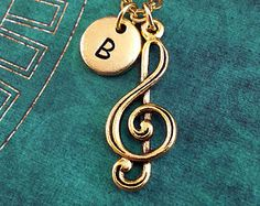 Items similar to Treble Clef Necklace, Gold Music Note Charm, Personalized Necklace, Pendant Necklace Musician Necklace Engraved Necklace Gold Music Keychain on Etsy Engraved Necklace, Personalized Necklace, Gold Necklace, Pendant Necklace, Infinity Music, Letter Charms, Treble Clef, Brass Chain, Violin