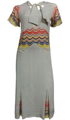 "1930s day dress in rayon ""cellanese"" with neck tie and bold print insets at midriff, sleeves, and godets skirt pleats, via 1stdibs.com/."