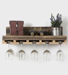 Reclaimed Wood Floating Wine Rack | Pair your reds and whites with your collection of wine glasses...