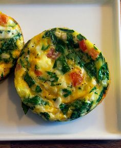 Spinach, Tomato and Cheese Muffin Tin Frittatas -- easy to make, easy to eat and even great when reheated. Perfect individual serving size.