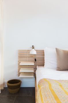The headboard doubles as a night stand without adding any extra furniture.