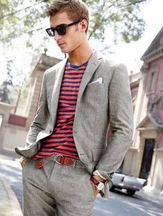 J.Crew men's Ludlow suit jacket, heathered T-shirt in warm red stripe, Ludlow suit pant and Irving sunglasses.